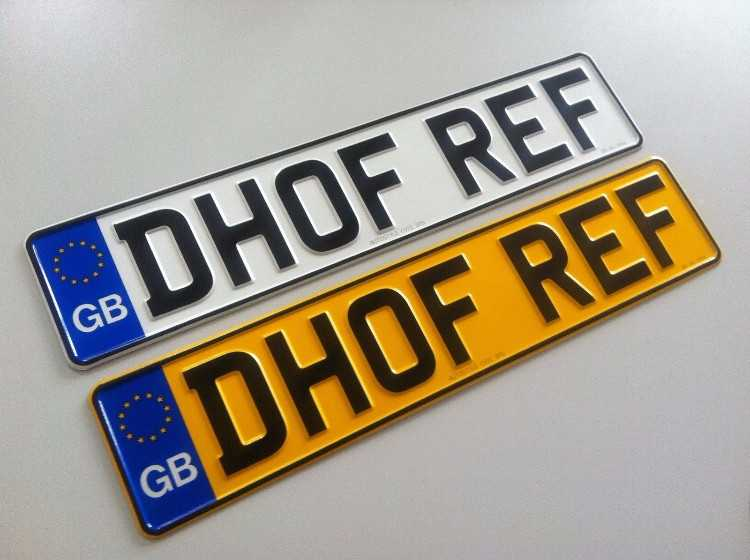 A PAIR OF ALUMINIUM PRESSED CAR NUMBER PLATES